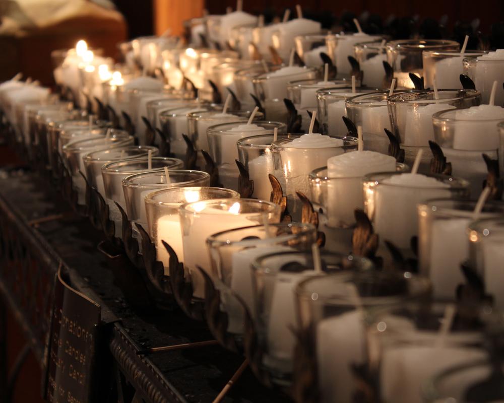 votive candles both lit and unlit