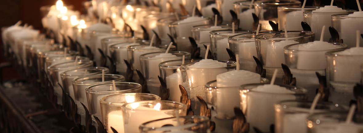 rows of votive candles